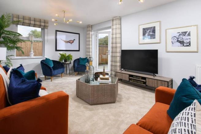 Bay-fronted triple-aspect lounge in Avondale style home, with French doors to rear garden