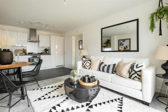 The open plan kitchen/living/dining area with a Juliet balcony