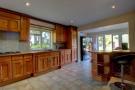 Kitchen with doors to Rear Garden