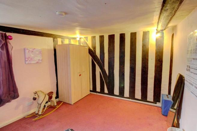 Bedroom With Feature Beamed Wall