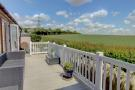 Balcony overlooking fields