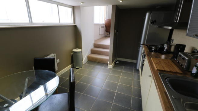 KITCHEN LEADING TO LOUNGE