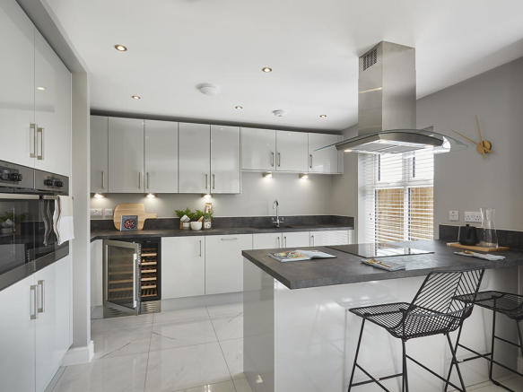 Fully integrated kitchen with stylish breakfast bar and full height window