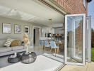 Light and spacious kitchen/dining/family area with bi-fold doors