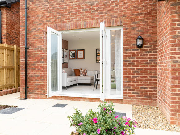 Bi-fold doors which lead to a rear turfed garden