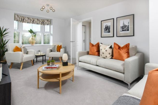 Bay-fronted lounge in Millford show home