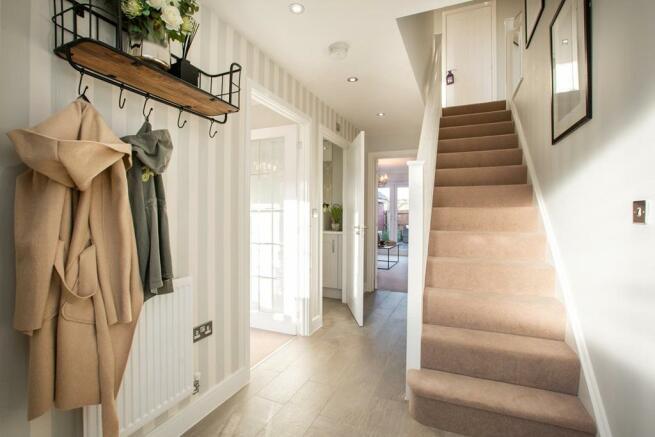 Bright hallway with under stairs storage