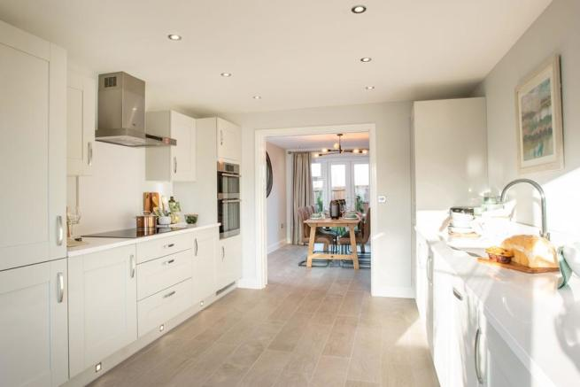 Galley style kitchen with double doors to reception room