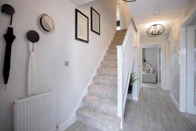 A warm entrance hall welcomes you home