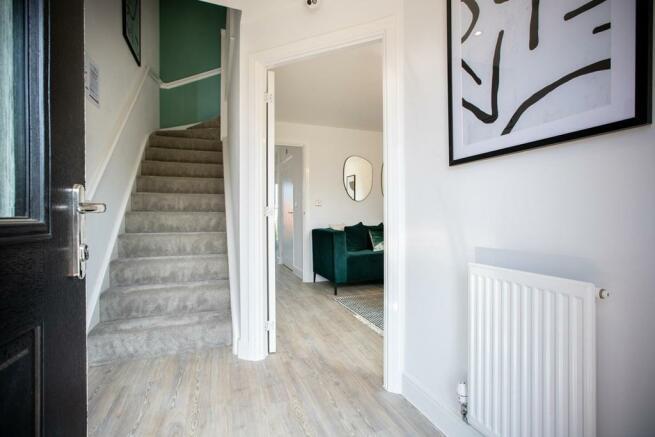 Bright hallway with under stair storage