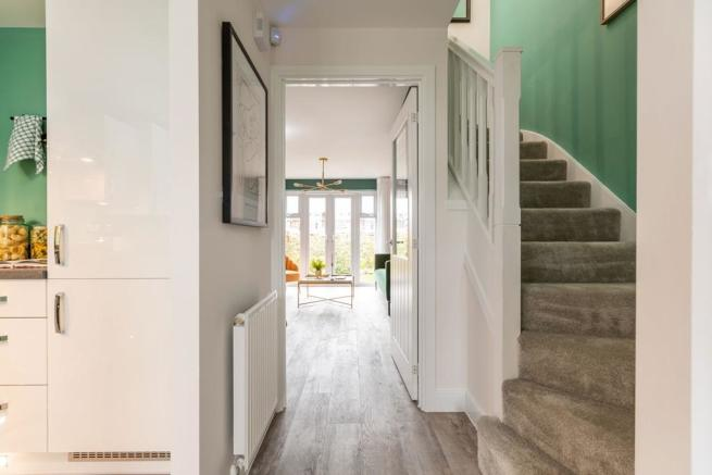 Bright hallway leading to the kitchen and lounge