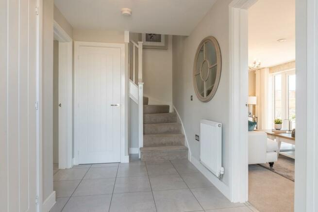 Entrance hallway with useful storage cupboard