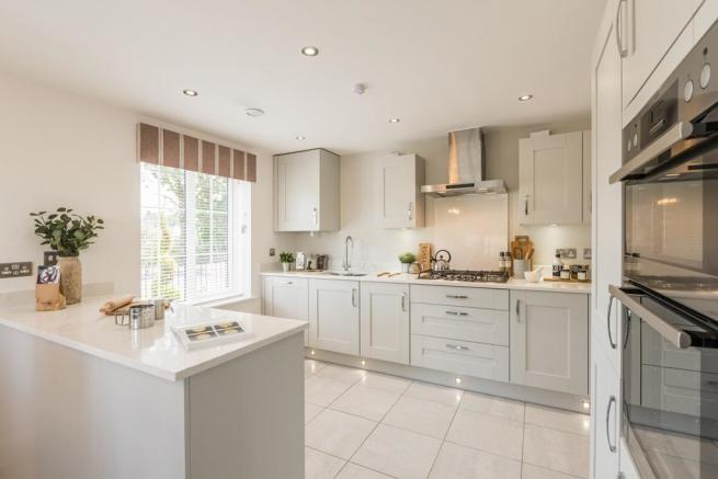 Beautifully designed kitchen with breakfast bar