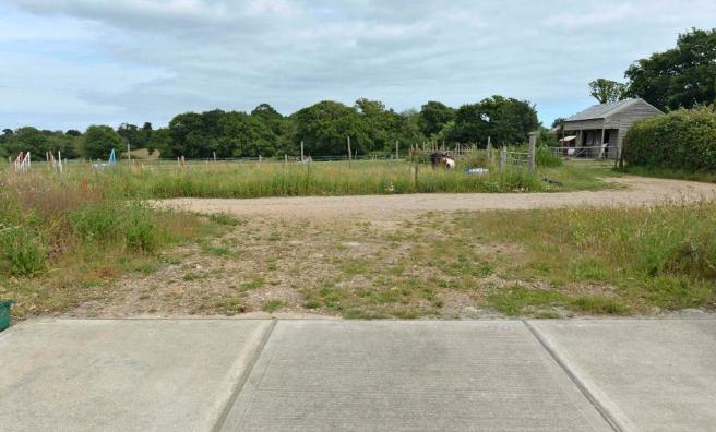 Parking area and fields to the rear