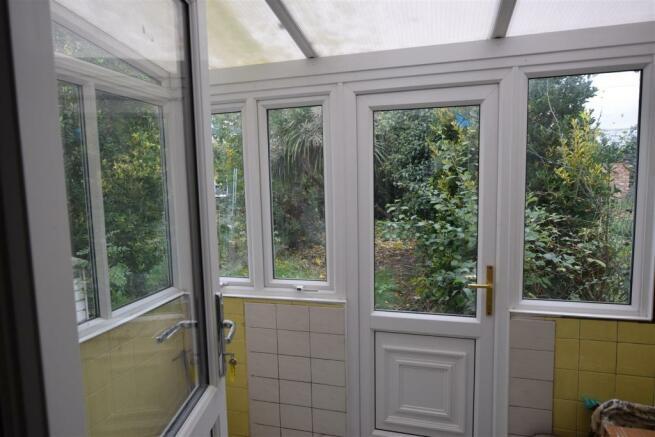 Double Glazed Conservatory/Utility Area: