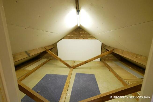 Loft/Storage Room:-