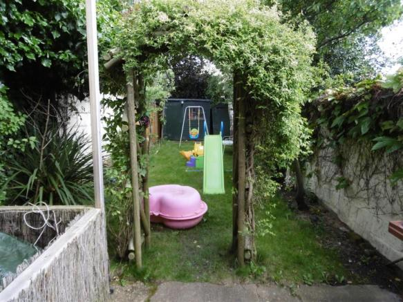 ARCHWAY THROUGH TO LAWNED AREA