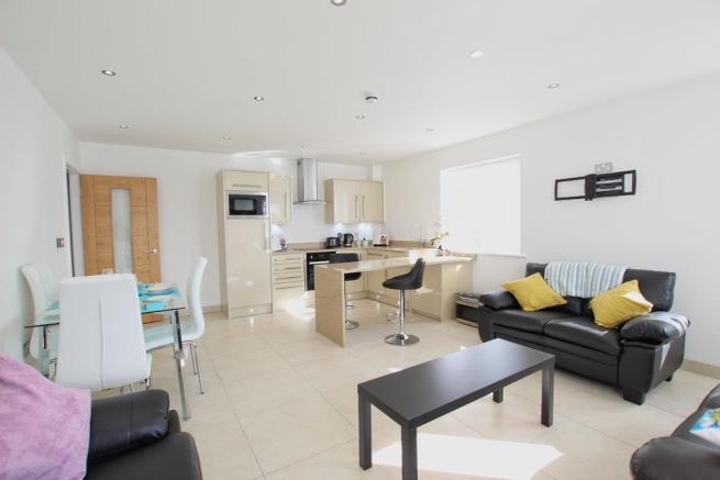 LOUNGE WITH OPEN PLAN KITCHEN AREA