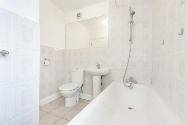 Fully tiled walls in bathroom