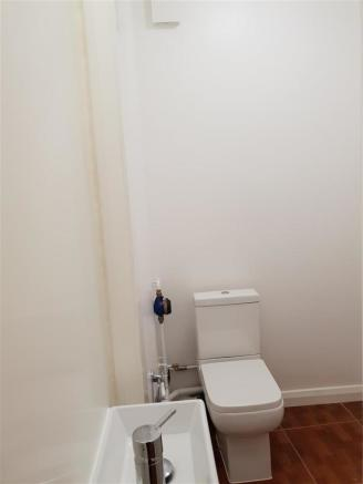 Newly fitted toilet and basin