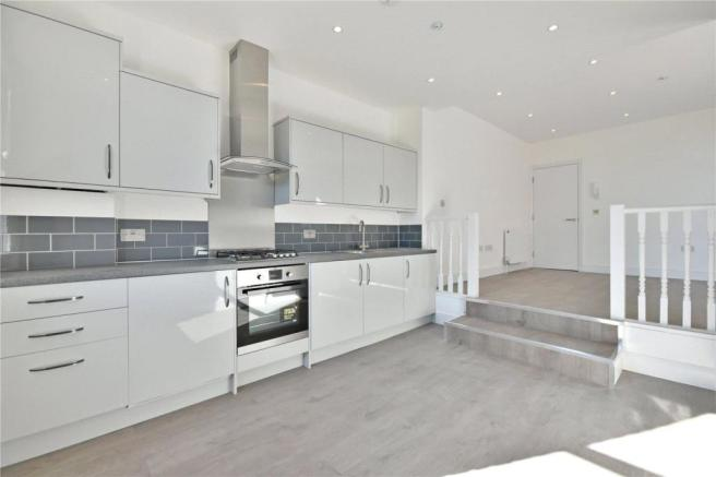 Newly fitted kitchen with stainless steel applianc