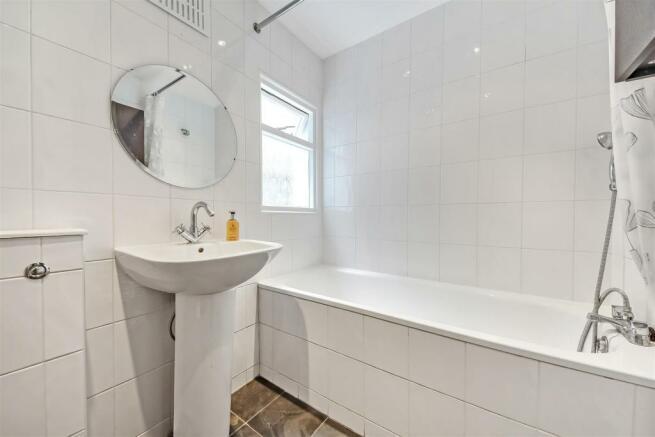 White coloured three piece suite