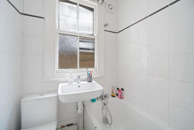 Fully tiled bathroom combined W.C
