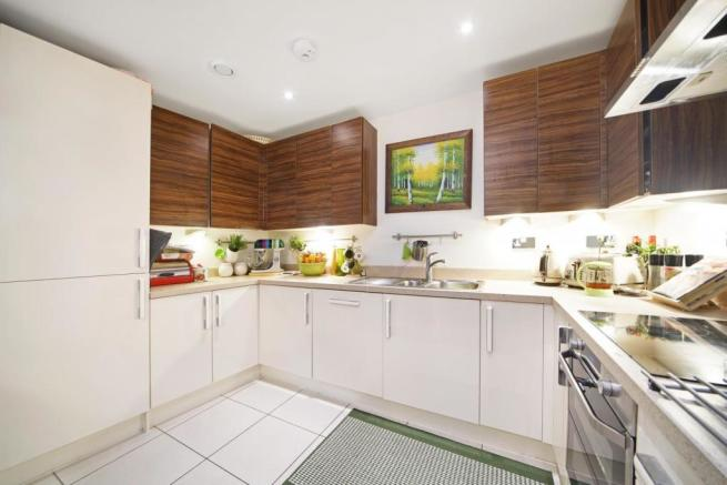 Modern fitted kitchen with compound worktops
