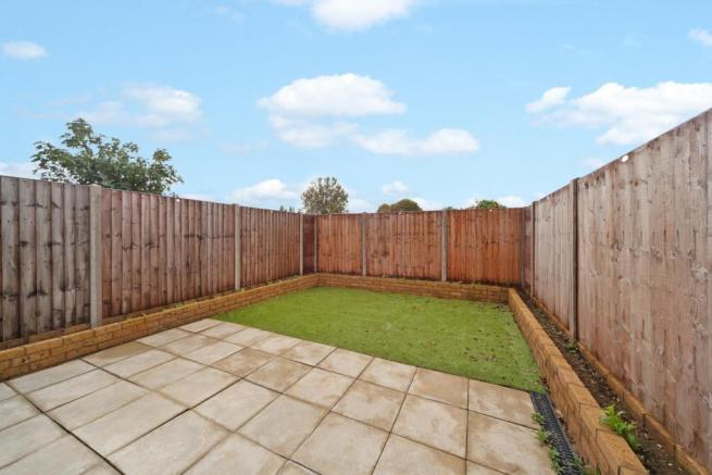 Private south facing rear garden mainly laid to la