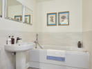 Extensively tiled bathroom