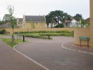 Communal lawns leading to allocated parking