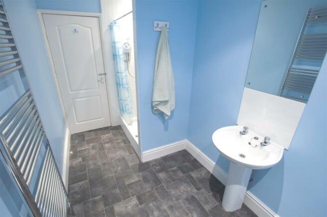 15 BLAKENEY ROAD Shower room front D11131162a.jpg