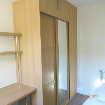 Bedroom 1 fitted wardrobe.JPG
