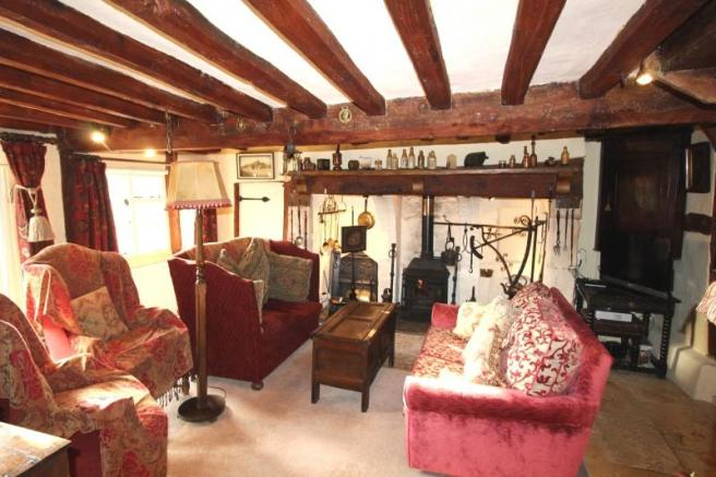 https://s3-eu-west-1.amazonaws.com/propertylab/allanmorris/property-images/standard/4507_The Old Post Office - Sitting Room new 2.JPG