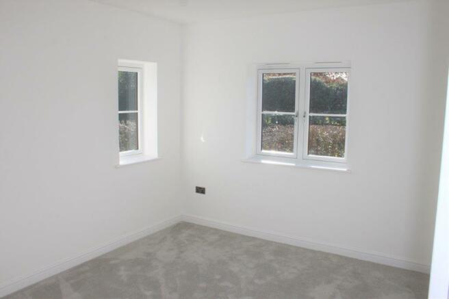 SITTING ROOM/DOUBLE BEDROOM FIVE