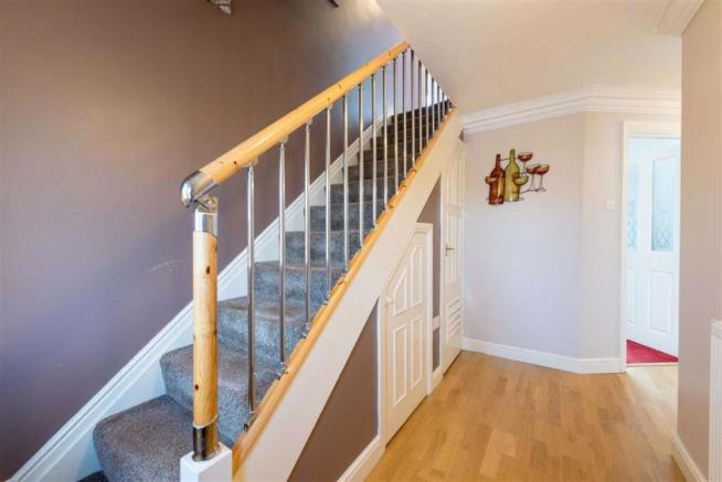 STAIRS LEAD FROM ENTRANCE HALL TO FIRST FLOOR