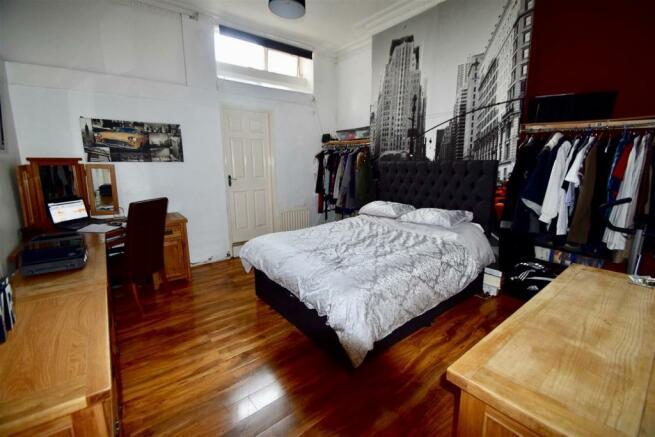 Bedroom 1 lightened (2).jpg