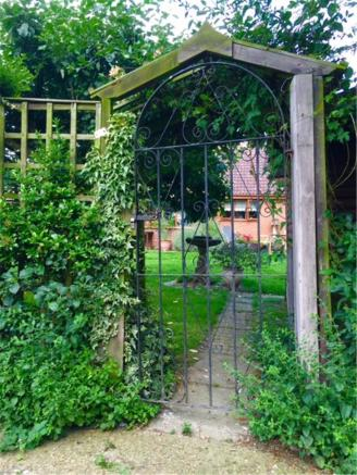Treetops garden gate from orchard area