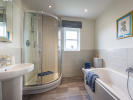 Extensively tiled bathroom with separate shower