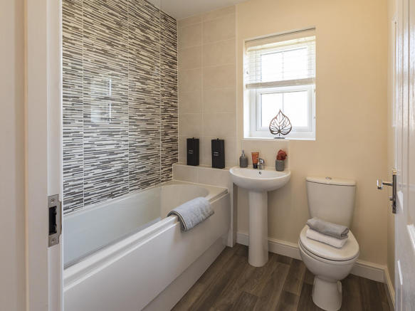 Family bathroom with feature wall
