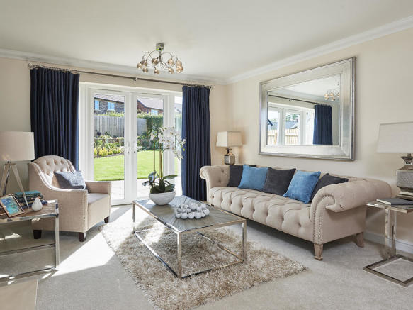 Light and spacious living area with French doors