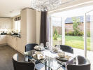 Kitchen and dining area with French doors to the outside