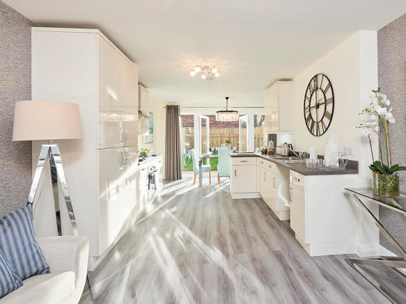 Open plan family room, fully integrated kitchen and dining area