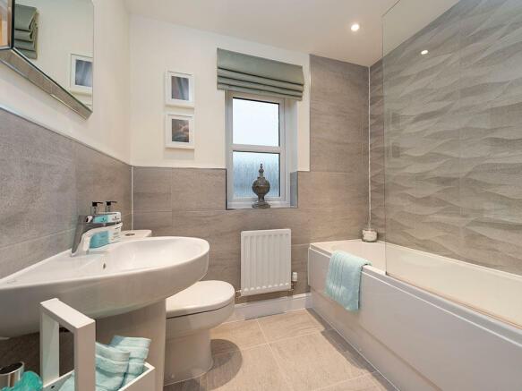 Extensively tiled family bathroom