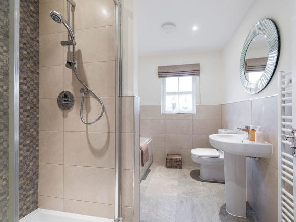 Extensive Porcelanosa tiling to family bathroom with separate shower cubicle and bath