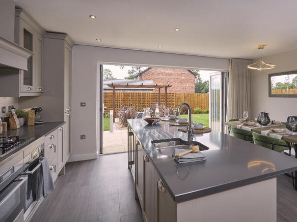 Large kitchen/family area with bi-fold doors to the garden