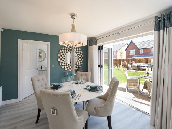 Contemporary bi-fold doors leading to the paved patio