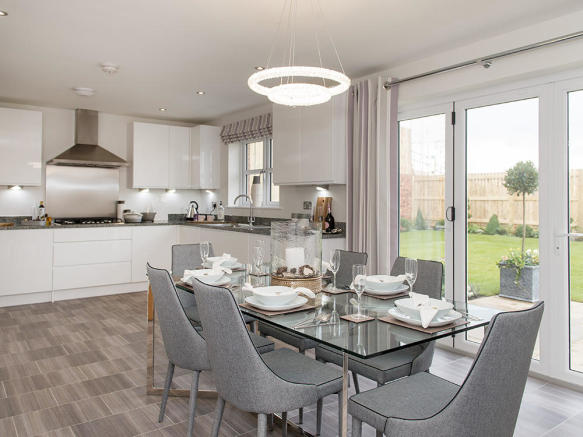 Kitchen / dining / family area with bi-fold doors to the garden