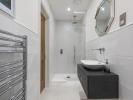 En-suite bathroom with separate shower