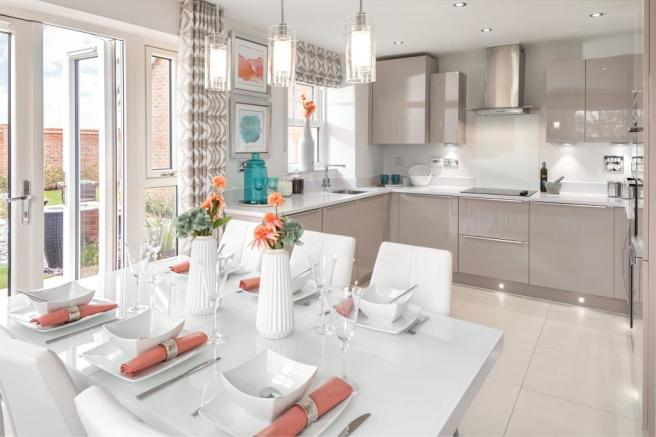 Open-plan kitchen diner with French doors to the garden